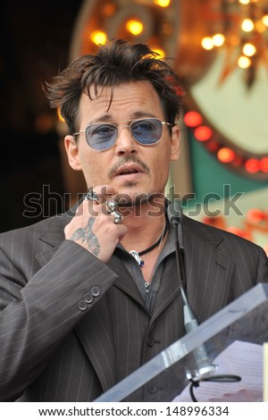 LOS ANGELES, CA - JUNE 24, 2013: Johnny Depp on Hollywood Boulevard where Jerry Bruckheimer was honored with the 2,501st star on the Hollywood Walk of Fame.  - stock photo