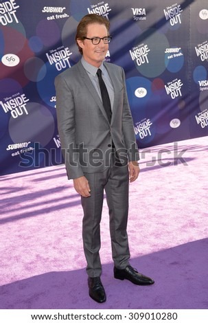 """LOS ANGELES, CA - JUNE 9, 2015: Kyle MacLachlan at the Los Angeles premiere of his movie Disney-Pixar's """"Inside Out"""" at the El Capitan Theatre, Hollywood.  - stock photo"""
