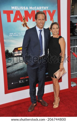 "LOS ANGELES, CA - JUNE 30, 2014: Nat Faxon & wife Meaghan Gadd at the premiere of his movie ""Tammy"" at the TCL Chinese Theatre, Hollywood.  - stock photo"