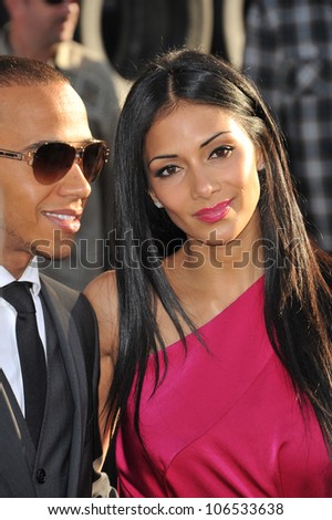 "LOS ANGELES, CA - JUNE 18, 2011: Nicole Scherzinger & Lewis Hamilton at the premiere of ""Cars 2"" at the El Capitan Theatre, Hollywood. June 18, 2011  Los Angeles, CA"