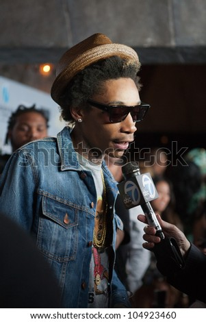 LOS ANGELES, CA - JUNE 11: Wiz Khalifa arrives to the Max & Devin go to High School premiere at the Fonda Theatre on June 11, 2012 in Los Angeles, CA. - stock photo