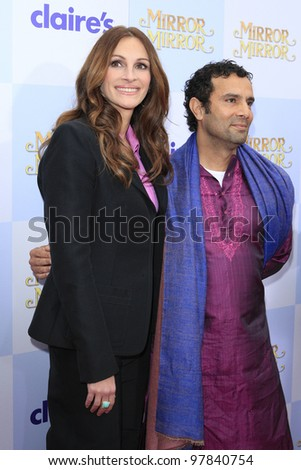 LOS ANGELES, CA - MAR 17: Julia Roberts, Tarsem Singh at Relativity Media's 'Mirror Mirror' premiere at Grauman's Chinese Theater on March 17, 2012 in Los Angeles, California - stock photo