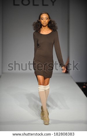 Los Angeles, CA - MARCH 13: A model walks the runway at Lolly Clothing fashion show during Style Fashion Week Fall 2014 at The LA Live Event Deck on March 13, 2014 in LA.