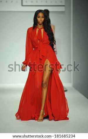 LOS ANGELES, CA - MARCH 10: A model walks the runway at Michael Costello fashion show during Style Fashion Week Fall 2014 at The Live Arena on March 10, 2014 in Los Angeles. - stock photo