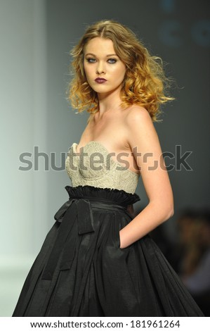 LOS ANGELES, CA - MARCH 10: A model walks the runway at MT Costello fashion show during Style Fashion Week Fall 2014 at The Live Arena on March 10, 2014 in Los Angeles.