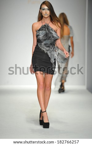 Los Angeles, CA - MARCH 13: A model walks the runway at Quynh Paris fashion show during Style Fashion Week Fall 2014 at The LA Live Event Deck on March 13, 2014 in LA.