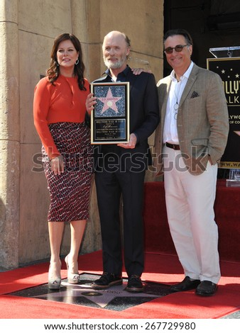 LOS ANGELES, CA - MARCH 13, 2015: Actor Ed Harris with Marcia Gay Harden & Andy Garcia on Hollywood Boulevard where he was honored with the 2,546th star on the Hollywood Walk of Fame.  - stock photo