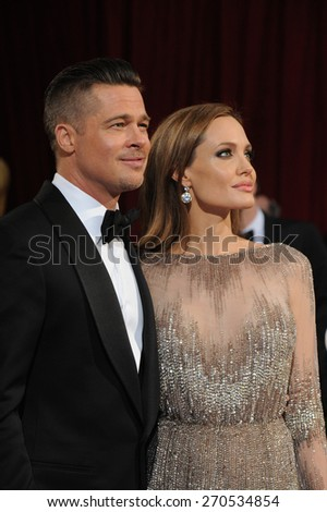 LOS ANGELES, CA - MARCH 2, 2014: Angelina Jolie & Brad Pitt at the 86th Annual Academy Awards at the Hollywood & Highland Theatre, Hollywood.  - stock photo