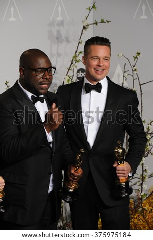LOS ANGELES, CA - MARCH 2, 2014: Brad Pitt & Steve McQueen at the 86th Annual Academy Awards at the Dolby Theatre, Hollywood.