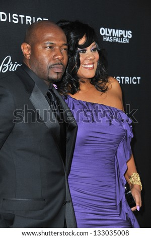 "LOS ANGELES, CA - MARCH 18, 2013: Director Antoine Fuqua & wife Lela Rochon at the Los Angeles premiere of his movie ""Olympus Has Fallen"" at the Cinerama Dome, Hollywood. - stock photo"