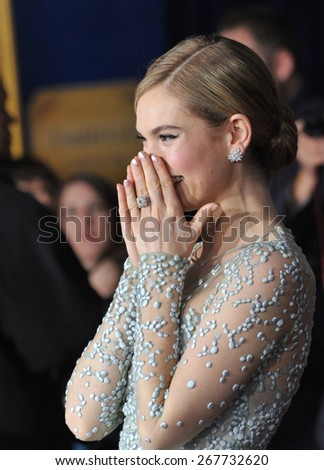 """LOS ANGELES, CA - MARCH 1, 2015: Downton Abbey star Lily James at the world premiere of her movie """"Cinderella"""" at the El Capitan Theatre, Hollywood.  - stock photo"""