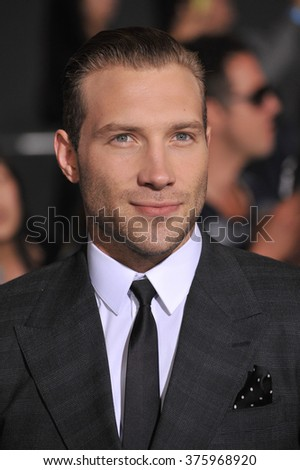 "LOS ANGELES, CA - MARCH 18, 2014: Jai Courtney at the Los Angeles premiere of his movie ""Divergent"" at the Regency Bruin Theatre, Westwood."