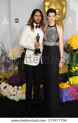 LOS ANGELES, CA - MARCH 2, 2014: Jared Leto & Anne Hathaway at the 86th Annual Academy Awards at the Dolby Theatre, Hollywood.