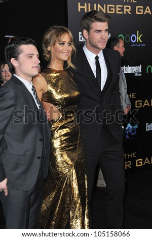 "LOS ANGELES, CA - MARCH 12, 2012: Jennifer Lawrence, Josh Hutcherson (left) & Liam Hemsworth at the world premiere of ""The Hunger Games"" at the Nokia Theatre L.A. Live March 12, 2012  Los Angeles, CA"