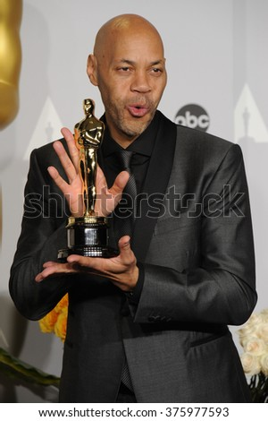 LOS ANGELES, CA - MARCH 2, 2014: John Ridley at the 86th Annual Academy Awards at the Dolby Theatre, Hollywood.
