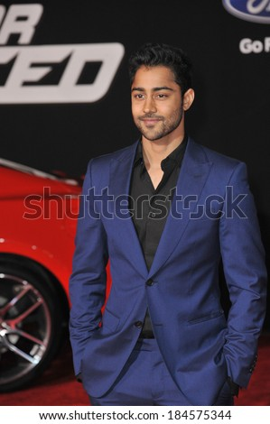 "LOS ANGELES, CA - MARCH 6, 2014: Manish Dayal at the U.S. premiere of ""Need for Speed"" at the TCL Chinese Theatre, Hollywood."