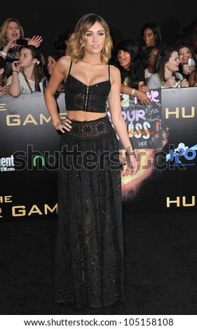 "LOS ANGELES, CA - MARCH 12, 2012: Miley Cyrus at the world premiere of ""The Hunger Games"" at the Nokia Theatre L.A. Live. March 12, 2012  Los Angeles, CA - stock photo"