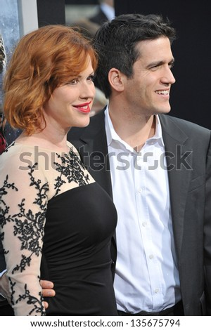 """LOS ANGELES, CA - MARCH 28, 2013: Molly Ringwald & Panio Gianopoulos at the Los Angeles premiere of """"G.I. Joe: Retaliation"""" at the Chinese Theatre, Hollywood. - stock photo"""