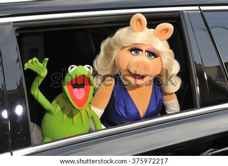 "LOS ANGELES, CA - MARCH 11, 2014: Muppets' characters Kermit the Frog & Miss Piggy at the world premiere of their movie Disney's ""Muppets Most Wanted"" at the El Capitan Theatre, Hollywood."