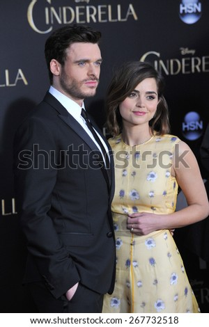 "LOS ANGELES, CA - MARCH 1, 2015: Richard Madden & actress girlfriend Jenna Coleman at the world premiere of his movie ""Cinderella"" at the El Capitan Theatre, Hollywood.  - stock photo"
