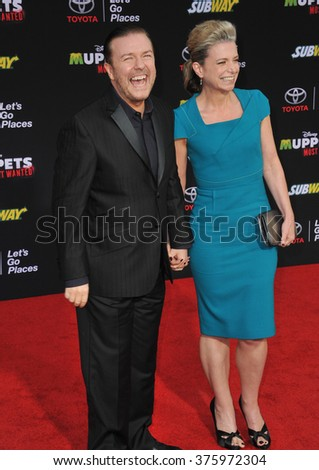 "LOS ANGELES, CA - MARCH 11, 2014: Ricky Gervais & Jane Fallon at the world premiere of his movie Disney's ""Muppets Most Wanted"" at the El Capitan Theatre, Hollywood."