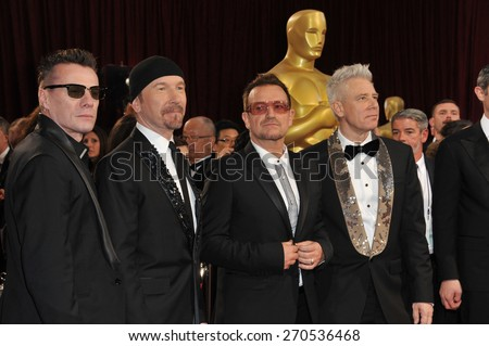 LOS ANGELES, CA - MARCH 2, 2014: U2 with Bono & The Edge at the 86th Annual Academy Awards at the Hollywood & Highland Theatre, Hollywood.  - stock photo