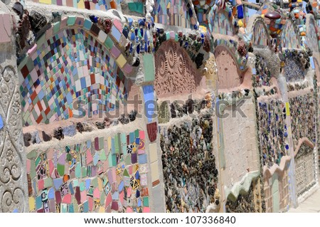 LOS ANGELES, CA - MAY 19: Detail of ceramic shards inlaid in cement at Watts Towers, Los Angeles on May 19, 2012. Simon Rodia used discarded pieces of broken pottery to decorate his towers.