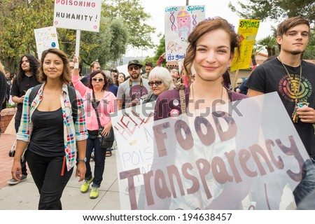 LOS ANGELES CA - MAY 24: Protesters rallied in the streets against the Monsanto corporation. The company is accused of genetically modifying foods unsafely. May 24, 2014 in Los Angeles, California.