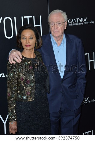 """LOS ANGELES, CA - NOVEMBER 17, 2015: Actor Michael Caine & wife Shakira at the Los Angeles premiere of his movie """"Youth"""" at the Directors Guild of America - stock photo"""