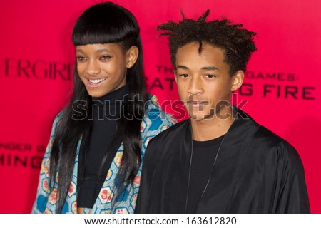 LOS ANGELES, CA - NOVEMBER 18: Actors Jaden Smith and Willow Smith arrive at the premiere of The Hunger Games: Catching Fire at the Nokia Theater in Los Angeles, CA on November 18, 2013 - stock photo