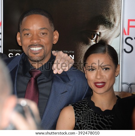 "LOS ANGELES, CA - NOVEMBER 10, 2015: Actors Will Smith & Gugu Mbatha-Raw at the premiere of their movie ""Concussion"" at the TCL Chinese Theatre - stock photo"