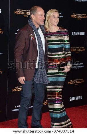 """LOS ANGELES, CA - NOVEMBER 16, 2015: Actress Elizabeth Banks & actor Woody Harrelson at the Los Angeles premiere of """"The Hunger Games: Mockingjay - Part 2"""" at the Microsoft Theatre, LA Live.   - stock photo"""