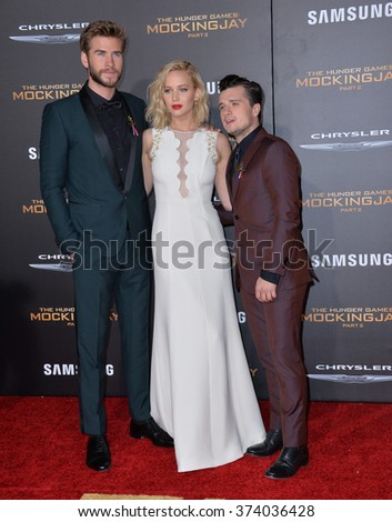 """LOS ANGELES, CA - NOVEMBER 16, 2015: Actress Jennifer Lawrence & actors Liam Hemsworth & Josh Hutcherson (right) at the premiere of """"The Hunger Games: Mockingjay - Part 2"""".   - stock photo"""