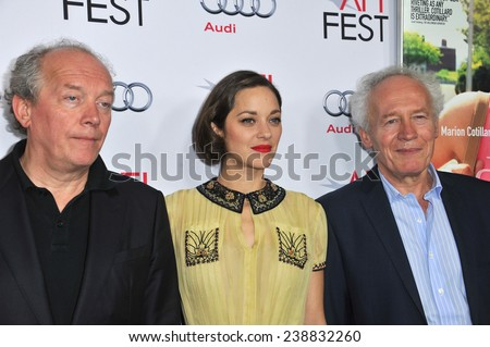 "LOS ANGELES, CA - NOVEMBER 7, 2014: Actress Marion Cotillard with directors Jean-Pierre Dardenne & Luc Dardenne at the AFI Fest screening of ""Two Days, One Night"" at the Egyptian Theatre, Hollywood.  - stock photo"