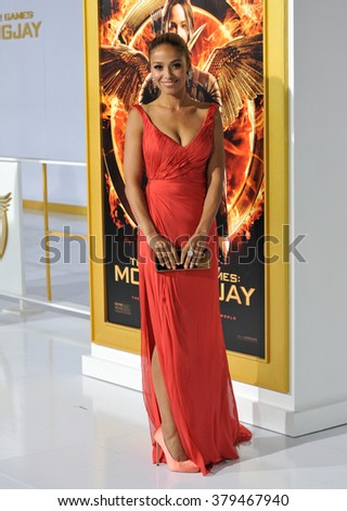 "LOS ANGELES, CA - NOVEMBER 17, 2014: Actress Meta Golding at the Los Angeles premiere of ""The Hunger Games: Mockingjay Part One"" at the Nokia Theatre LA Live. - stock photo"