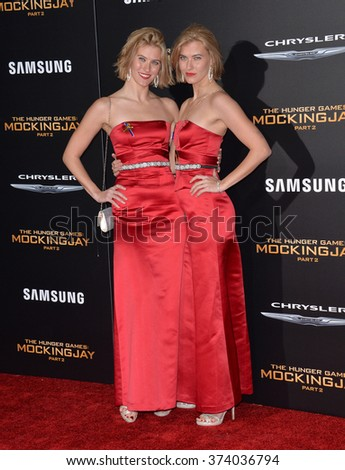 """LOS ANGELES, CA - NOVEMBER 16, 2015: Actresses Kim & Misty Ormiston at the Los Angeles premiere of their movie """"The Hunger Games: Mockingjay - Part 2"""" at the Microsoft Theatre, LA Live.  - stock photo"""