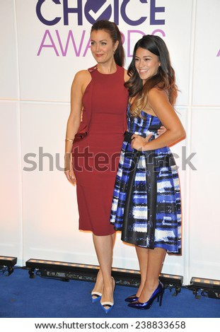 LOS ANGELES, CA - NOVEMBER 4, 2014: Bellamy Young & Gina Rodriguez (right) at the nominations announcement for the 2015 People's Choice Awards at the Paley Center for Media, Beverly Hils.  - stock photo
