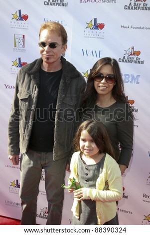 LOS ANGELES, CA - NOVEMBER 06: Billy Bob Thornton and family arrives at A Day Of Champions Benefiting the Bogart Pediatric Cancer Research Program at Sports Museum of Los Angeles on November 6, 2011. - stock photo