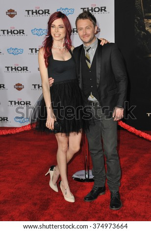 "LOS ANGELES, CA - NOVEMBER 4, 2013: Chloe Dykstra & Chris Hardwick at the US premiere of ""Thor: The Dark World"" at the El Capitan Theatre, Hollywood. Picture: Paul Smith / Featureflash - stock photo"