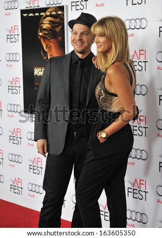 "LOS ANGELES, CA - NOVEMBER 9, 2013: Delta Goodrem & Gavin DeGraw at the Los Angeles premiere of ""Out of the Furnace"", part of the AFI Fest 2013, at the TCL Chinese Theatre, Hollywood."