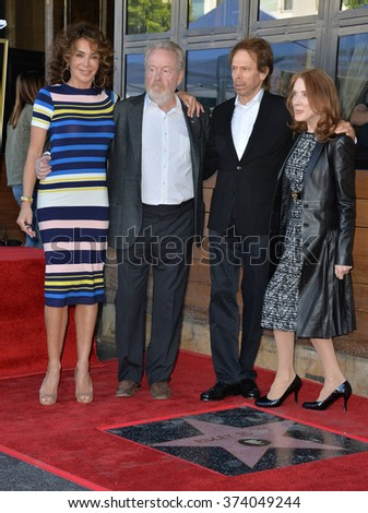 LOS ANGELES, CA - NOVEMBER 5, 2015: Director Ridley Scott & partner Giannina Facio, producer Jerry Bruckheimer & wife Linda on Hollywood Boulevard where he was honored with a star on the Walk of Fame  - stock photo