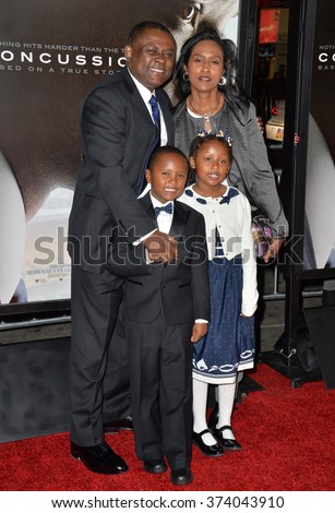 """LOS ANGELES, CA - NOVEMBER 10, 2015: Dr. Bennet Omalu & wife Prema Mutiso & children Ashly Omalu & Mark Omalu at the premiere of the movie based on his work """"Concussion"""" at the TCL Chinese Theatre.  - stock photo"""