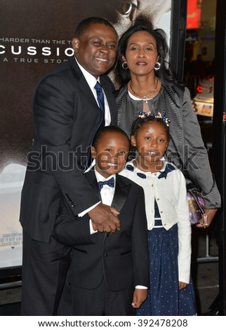 "LOS ANGELES, CA - NOVEMBER 10, 2015: Dr. Bennet Omalu & wife Prema Mutiso & children Ashly Omalu & Mark Omalu at the premiere of the movie based on his work ""Concussion"" at the TCL Chinese Theatre"