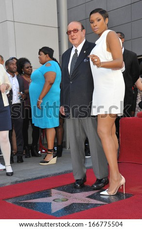 LOS ANGELES, CA - NOVEMBER 13, 2013: Jennifer Hudson & music mogul Clive Davis on Hollywood Boulevard where she was honored with the 2,512th star on the Hollywood Walk of Fame.  - stock photo