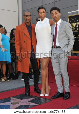 LOS ANGELES, CA - NOVEMBER 13, 2013: Jennifer Hudson with Raphael Saadiq (left) & Jacob Latimore on Hollywood Boulevard where she was honored with the 2,512th star on the Hollywood Walk of Fame.  - stock photo