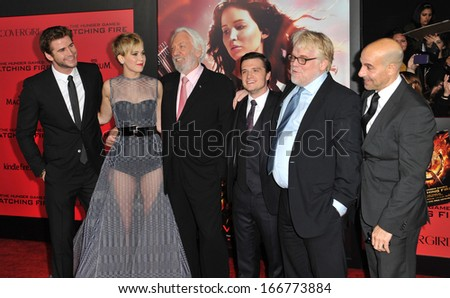 "LOS ANGELES, CA - NOVEMBER 18, 2013: Jennifer Lawrence, Liam Hemsworth, Donald Sutherland, Josh Hutcherson, Philip Seymour Hoffman & Stanley Tucci at premiere of ""The Hunger Games: Catching Fire""  - stock photo"
