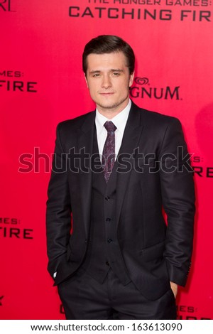 LOS ANGELES, CA - NOVEMBER 18: Josh Hutcherson arrives at the premiere of The Hunger Games: Catching Fire at the Nokia Theater in Los Angeles, CA on November 18, 2013 - stock photo