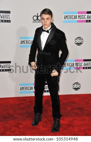 LOS ANGELES, CA - NOVEMBER 20, 2011: Justin Bieber arriving at the 2011 American Music Awards at the Nokia Theatre, L.A. Live in downtown Los Angeles. November 20, 2011  Los Angeles, CA - stock photo