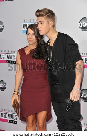LOS ANGELES, CA - NOVEMBER 18, 2012: Justin Bieber & mother at the 40th Anniversary American Music Awards at the Nokia Theatre LA Live. - stock photo