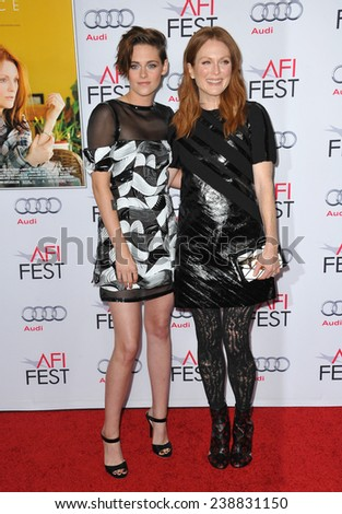 "LOS ANGELES, CA - NOVEMBER 12, 2014: Kristen Stewart & Julianne Moore at the premiere of their movie ""Still Alice"" as part of the AFI FEST 2014 at the Dolby Theatre, Hollywood.   - stock photo"